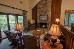 Comfy and cozy living area with stone fireplace
