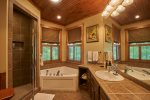 Master bath with spa tub and separate shower