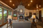 Soaring ceilings and massive stone fireplace in great room