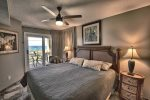 Sleep late while on vacation in the Comfy King Bed in the master bedroom.