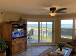 Take in some TV and enjoy the waterfront view.