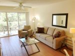 Enjoy Your Stay in a Spacious Living Room that opens onto a large 2nd floor balcony