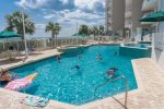 The Outdoor Pool with seating all around overlooks the beautiful Gulf Coast Water