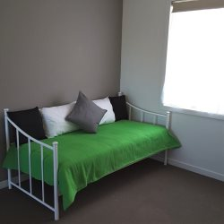 Single bed upstairs in study area.