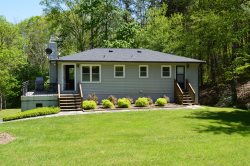 This single story 2 bedroom, 1 bath bungalow offers you a feeling of nature and tranquility in a peaceful, outdoor environment, yet close to all modern convenience of Canton, Waynesville, Maggie Valley and Asheville.