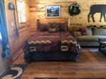 Queen log bed in Living Area