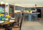 The open floor plan kitchen and dining areas