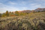 Secluded in a meadow of sage and wildflowers, encompassed by mountains