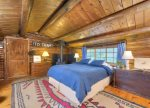 The master bedroom hosts a king-sized bed