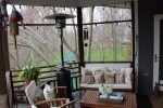 Enjoy morning coffee on the screened in porch overlooking Back Creek
