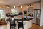 A gorgeous kitchen with stainless steel appliances, double oven, and granite countertops
