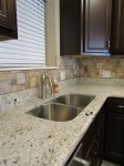 sink showing the beautiful countertops