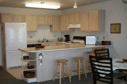 The fully furnished kitchen with extra seating