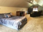 Loft bedroom with queen bed
