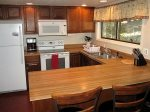 The kitchen has a breakfast bar. The fresh roasted whole bean coffee is compliments of Cielo Vista Vacation Properties