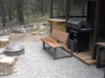 Outside the front door is the barbecue area with grill, fire pit, and bar. Partially covered.