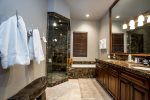 Master Bathroom has Marble Stand up shower, tub and double sinks