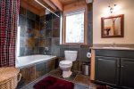 Master bath has a large soaking tub which is great for after skiing and hiking