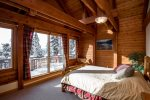 Queen bedroom with large windows and deck for relaxing