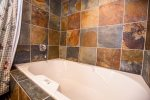 Enjoy the large soaking tub after a day of skiing or hiking