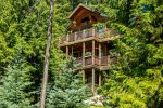 Enjoy three floors of mountain living in this Ptarmigan Village home