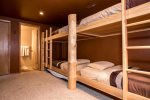 Bunk room with 4 twin beds.