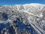 Drone view of Wood Run Ski Cottage and its Close Proximity to Whitefish Base Lodge