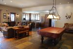 Inside of the clubhouse - full kitchen, pool table, and cozy sofas