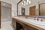 Double vanity gives everyone their own space & a large walk-in closet