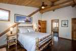Upstairs bedroom with comfortable queen size bed and private bathroom