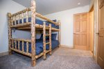 Bedroom 3 has full-size Montana style log bunk bed, closet, and dresser