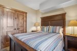 The kitchen has granite counters and lots of storage space, with a gas range