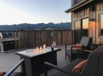 Relax by the fire table & enjoy the view of Big Mountain on this large balcony