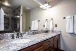 Master bathroom has granite countertops with his and hers sinks