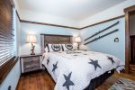 Cowboy bedroom has a Queen-size bed and closet space for your things