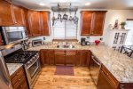 Granite countertops and stainless steel appliances in this charming kitchen