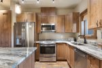 Granite counters, Stainless steel appliances, Gas range, Stacked Washer & dryer