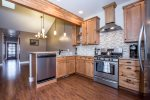Granite counter tops and stainless steel appliances with gas range