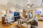 The Blue Bear condo features a cozy and inviting living room with comfy seating.