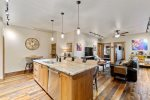 Kitchen features island bar with seating for six. Also a Stacked washer & dryer