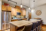 Beautiful granite countertops and stainless steel appliances in open kitchen.