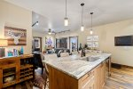 Open kitchen layout with stainless steel appliances. Washer & dryer in unit.