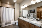 The master bath has a tub/shower combo and double vanity