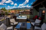 Enjoy the fire table, and hot tub with gorgeous views up to Whitefish Mountain