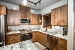 Stainless steel appliances and granite counter tops