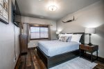 The master features a king-size bed, flatscreen tv, and views of the mountains