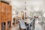 Master bedroom features a large flatscreen TV, beautiful decor, and king bed.