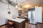 Fully equipped kitchen with stainless steel appliances and gas range
