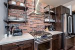 Beautiful brick detail in the kitchen, with everything you need for a night in