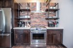 Stunning brick back-splash and gas range